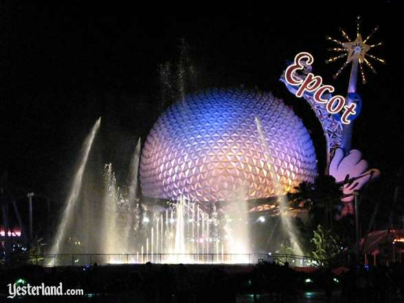 Photo of Epcot Icon Tower and Spaceship Earth with fountain at night