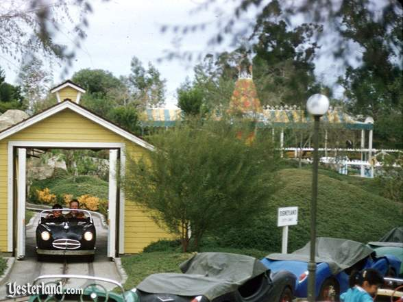 Photo of Fantasyland Depot behind the Midget Autopia