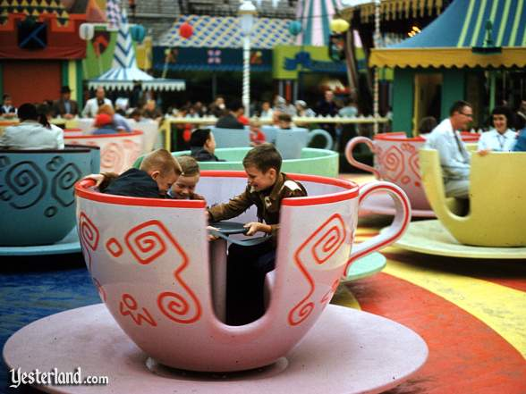 Photo of Mad Tea Party  with children spinning a pink cup